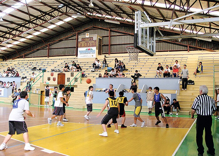 Taylors High School students are playing a basketball match.