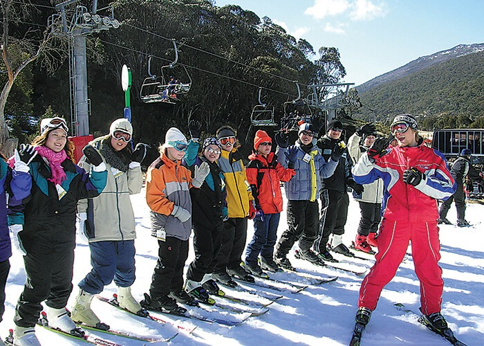 Taylors High School students are in the snow getting ready to ski.