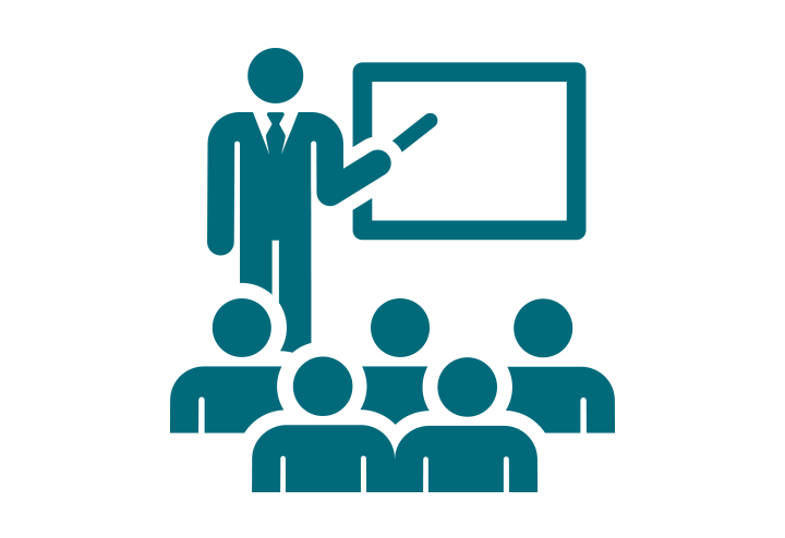 An image icon of students and a teacher in a classroom.